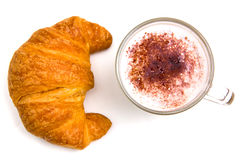Cappuccino and croissant from Royalty Free Stock Photography