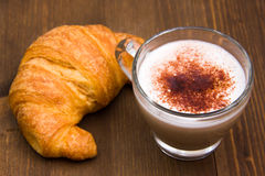 Cappuccino and croissant on wood Royalty Free Stock Photography