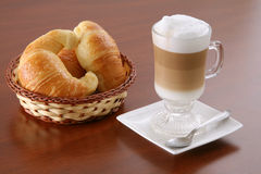 Cappuccino and croissants Stock Photos