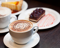 Cappuccino cup. On a restoran royalty free stock photo