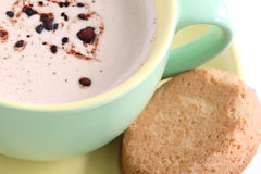 Cappuccino. A cup of cappuccino with biscuit Royalty Free Stock Photos