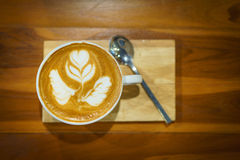 Cappuccino cup on the brown wooden table Stock Images