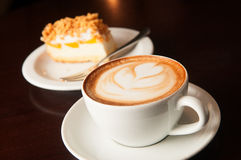 Cappuccino cup with cake Stock Image