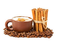 Cappuccino in a cup coffee grains with cinnamon sticks Stock Images