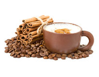 Cappuccino in a cup coffee grains with cinnamon sticks Stock Photos