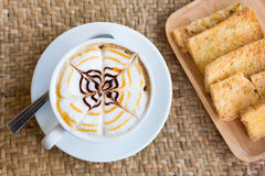 Cappuccino cup with crispy butter Royalty Free Stock Photography