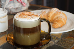 Cappuccino. Cup of cappuccino with croissant Stock Image