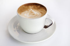 Cappuccino cup with drawing on scum Stock Photo