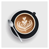 Cappuccino cup with hearts design on top. Stock Photography