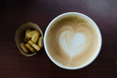 Cappuccino. A cup of hot cappuccino with biscuits Royalty Free Stock Image