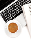 Cappuccino cup on laptop. Above view Royalty Free Stock Photo