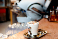 Cappuccino cup. A cup of cappuccino on a marble surface Royalty Free Stock Photo