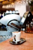 Cappuccino cup. A cup of cappuccino on a marble surface Royalty Free Stock Photos
