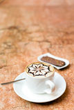 Cappuccino cup. A cup of cappuccino on a marble surface Stock Photography