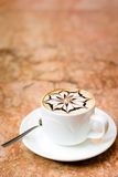 Cappuccino cup. A cup of cappuccino on a marble surface Stock Images