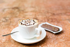 Cappuccino cup. A cup of cappuccino on a marble surface Royalty Free Stock Images