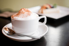 A cappuccino cup with milk foam Royalty Free Stock Image