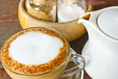Cappuccino cup with milk foam. On wooden table Stock Photography