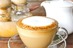 Cappuccino cup with milk foam. On wooden table Royalty Free Stock Photo