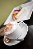 Cappuccino cup with milk foam and cinnamon Royalty Free Stock Photography