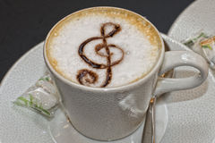 Cappuccino Cup with a violin clef Royalty Free Stock Image