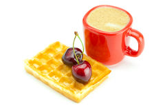 Cappuccino cup, waffles and cherries Royalty Free Stock Images