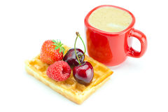 Cappuccino cup, waffles, cherries, strawberries Stock Photography