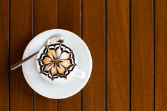 Cappuccino cup. A cup of cappuccino on a wooden surface Stock Photography