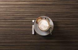 Cappuccino de cima com da colher Foto de Stock