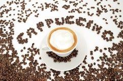 Cappuccino de la palabra y una taza de café Imagenes de archivo