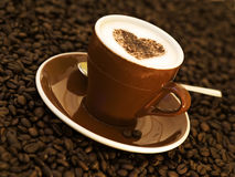 Cappuccino decorated with heart shape Royalty Free Stock Image
