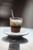 Cappuccino Delight. Photo Of A Glass Of Cappuccino With Foamy Cream Royalty Free Stock Image