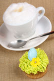 Cappuccino and Easter cupcake Stock Images