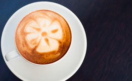 Cappuccino_with_flower. Cappuccino cup with flower incide Stock Image