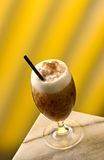 Cappuccino Frappe. With choco flakes and black straw Stock Images