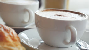 Cappuccino with a French roll for breakfast Royalty Free Stock Photo