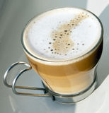 Cappuccino in a glass cup Stock Photos