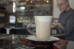 Cappuccino in glass mug Stock Photo