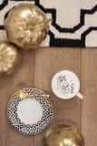Cappuccino and gold pumpkins on wooden floor. Stripe design Stock Photos