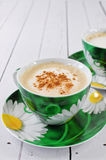 Cappuccino in green cup Royalty Free Stock Images