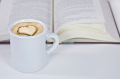 Cappuccino with heart design and book Royalty Free Stock Photo