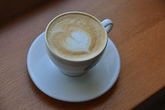 Cappuccino with heart design in foam Stock Image