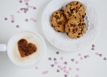 Cappuccino with heart pattern of cinnamon and cookies Stock Image