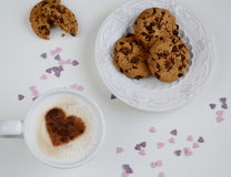 Cappuccino with heart pattern of cinnamon and cookies Stock Photography