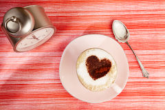 Cappuccino with heart, red stripy backdrop Royalty Free Stock Photo