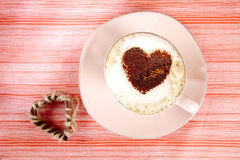 Cappuccino with heart red stripy backdrop Royalty Free Stock Photos