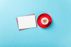 Cappuccino with heart shape and envelope Royalty Free Stock Images