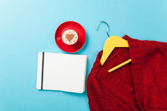 Cappuccino with heart shape and notebook with hanger Royalty Free Stock Photos