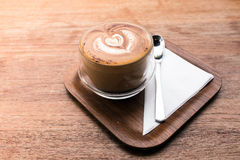 Cappuccino hot coffee in the cup on the table background Stock Images