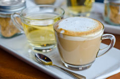 Cappuccino. With hot tea and sugar Royalty Free Stock Photography